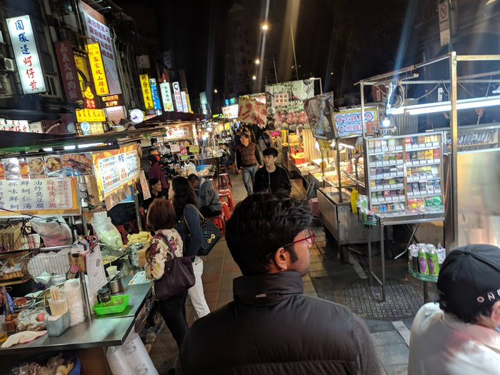 Saurya walking through the Night Market. Click for full-size image.