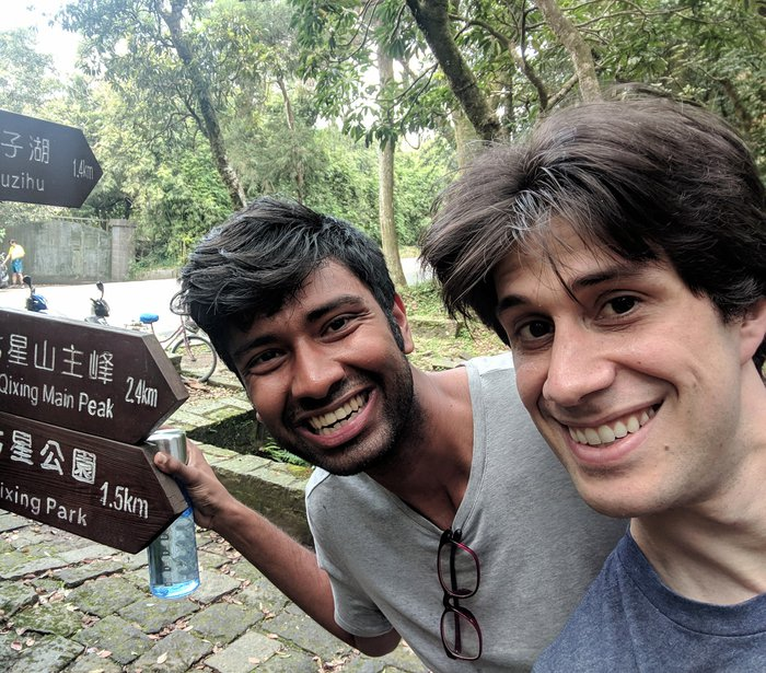 Saurya and I posing by a sign at the National Park advertising Qixing Main Peak, at 2.4km. Click for full-size image.