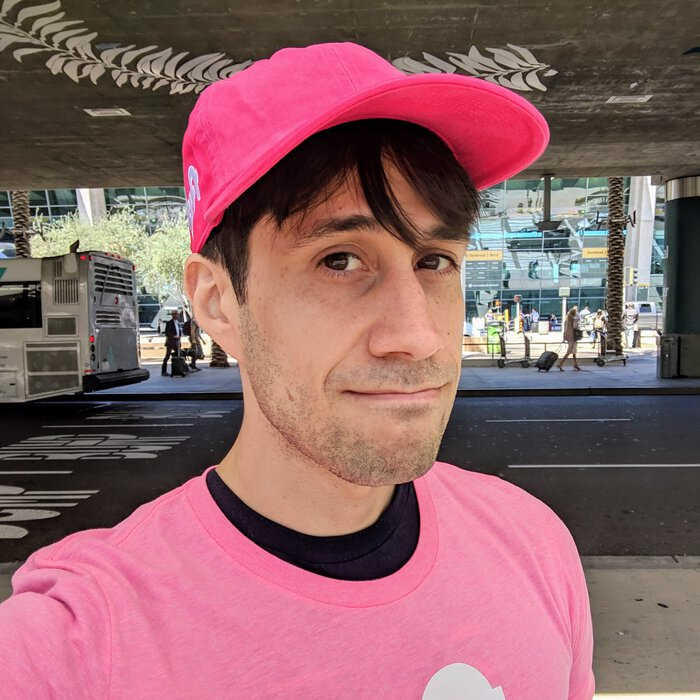 Pablo in a Lyft hat and Lyft T-Shirt. Click for full size.