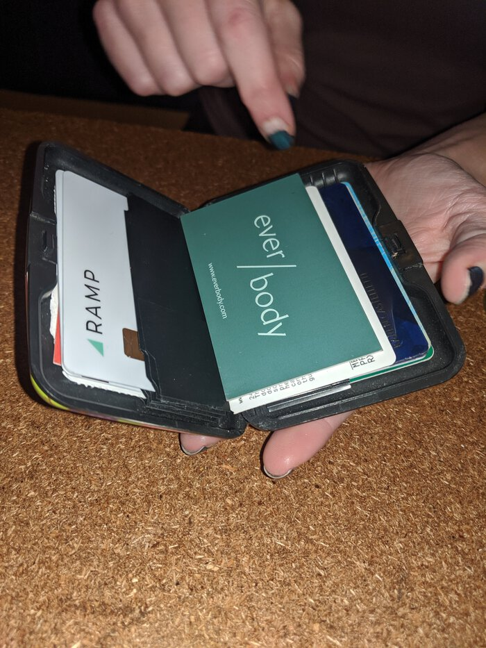 Karen's wallet showing an EverBody business card and her Ramp card. Click for full size.