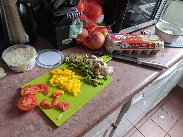 Lots of chopped veggies + ingredients.