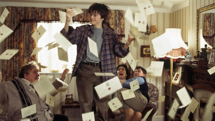 Harry Potter and the Dursleys, covered in envelopes.