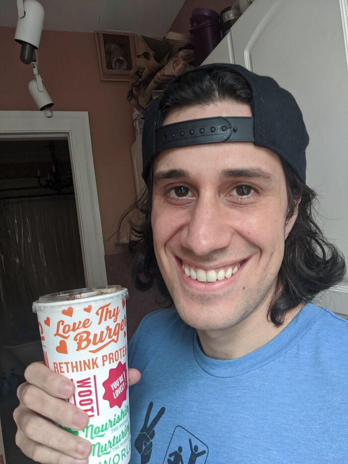 Photo of me, smiling with a shake.